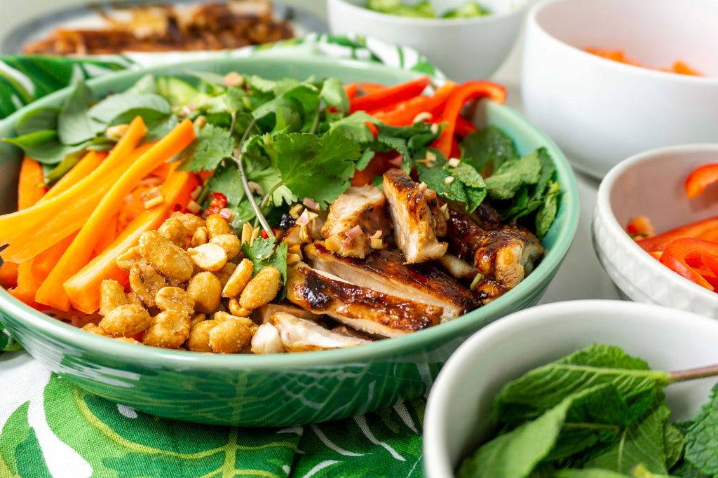 Caramelised chicken in a Vietnamese chicken noodle salad with crunchy raw vegetables