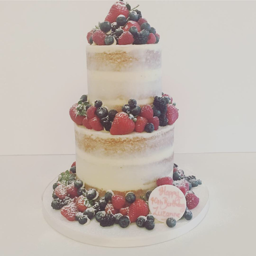 Two Tier Semi Naked Cake with an Abundance of Fresh Fruit
