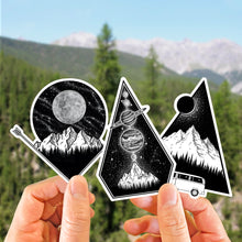 Load image into Gallery viewer, hands holding up a set of three illustrated mountain stickers