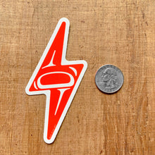 Load image into Gallery viewer, red alaska native lightning bolt vinyl sticker next to a quarter