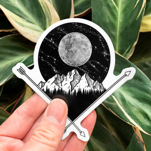 black and white macbook sticker of a full moon above a mountain illustration
