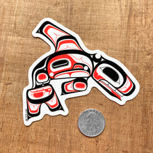 Load image into Gallery viewer, tlingit killer whale laptop vinyl sticker next to a quarter