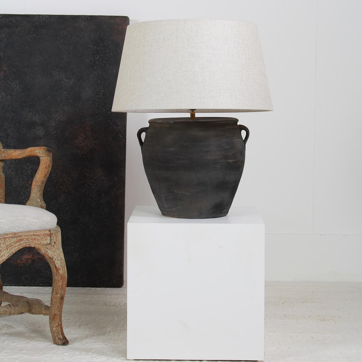 AUTHENTIC BLACK POTTERY LAMP WITH WHITE LINEN DRUM SHADE