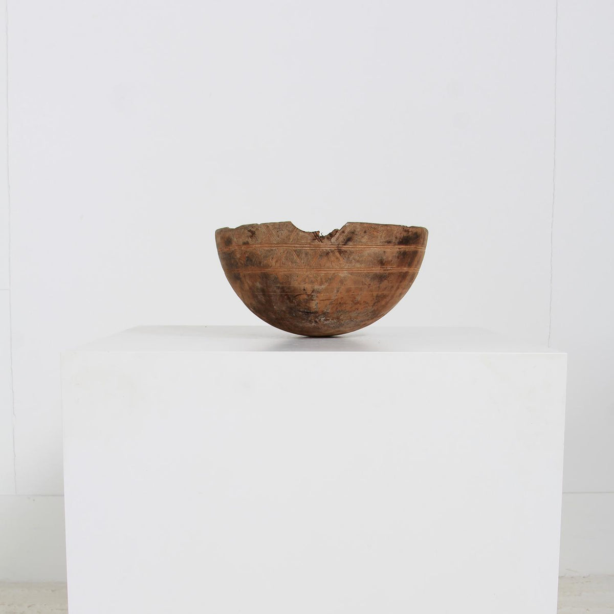 Tribal Wooden Bowl with Carved Design