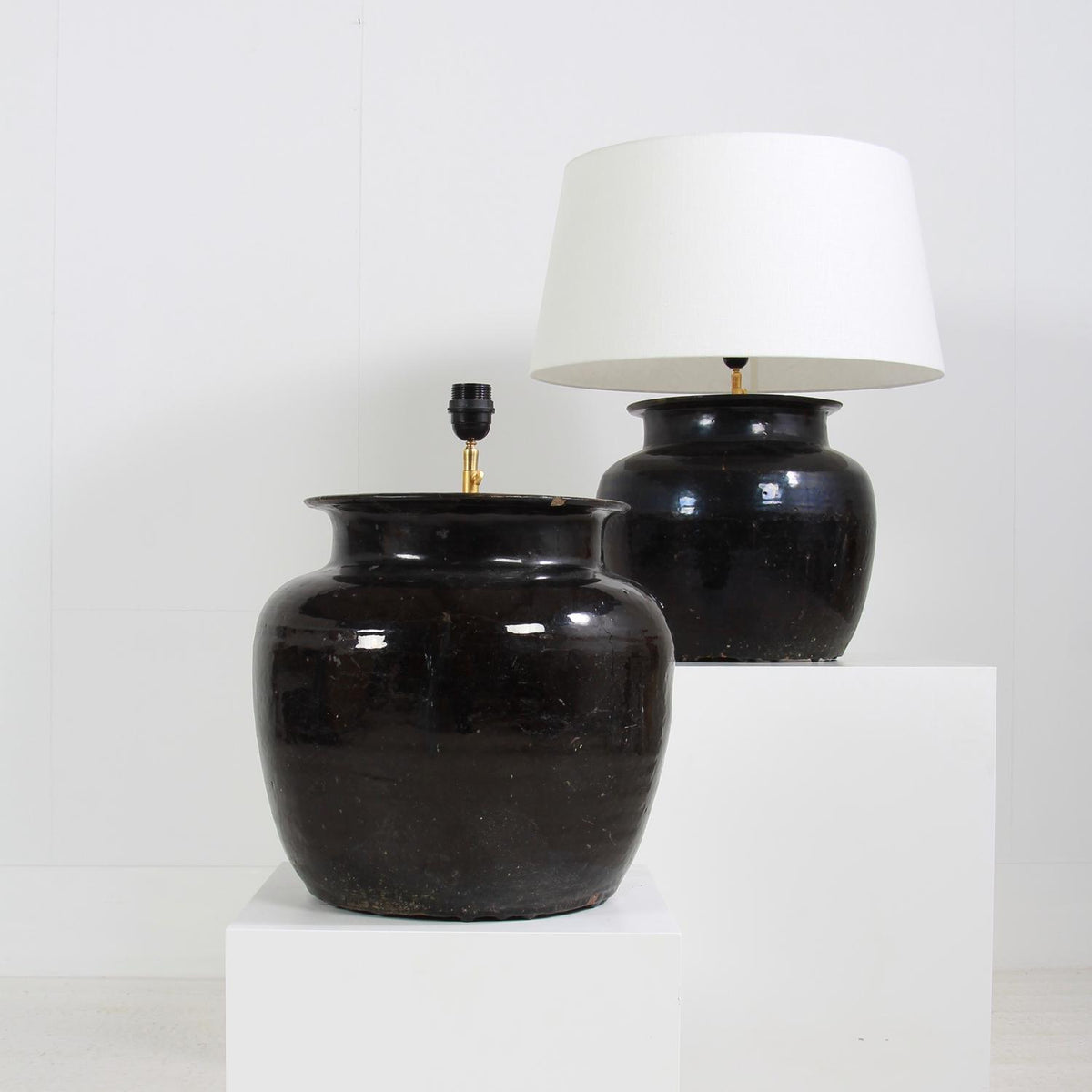 Monumental Antique Black Glazed  Pottery Lamps with White Linen Shades
