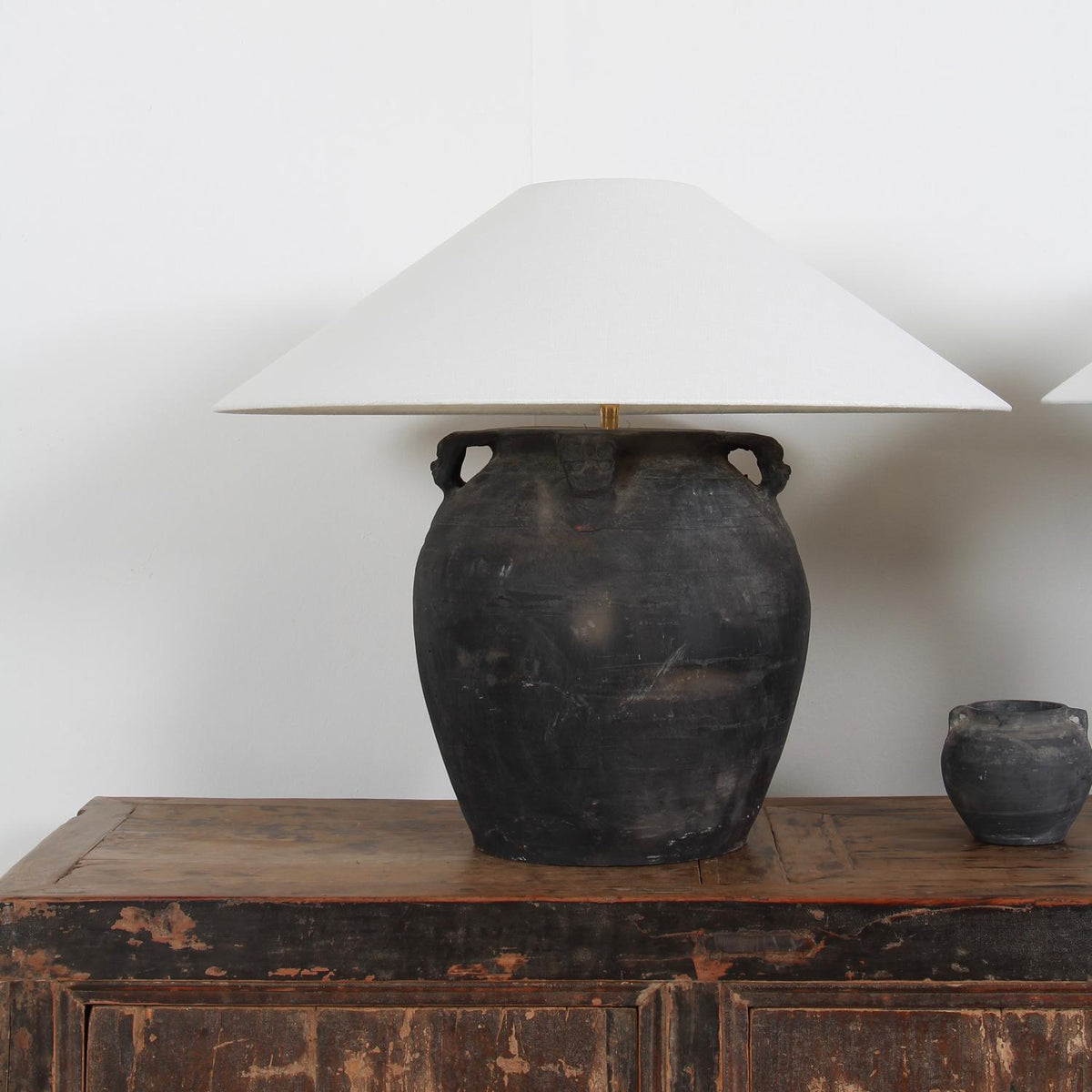 PAIR OF LARGE BLACK  POTTERY LAMPS WITH WHITE LINEN SHADES