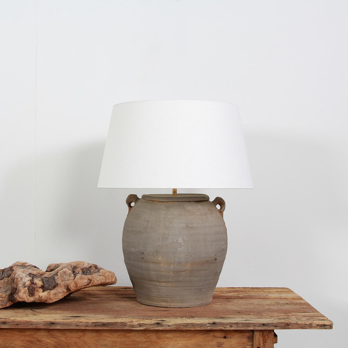 TERRACOTTA UNGLAZED POTTERY LAMP WITH NATURAL LINEN DRUM SHADE
