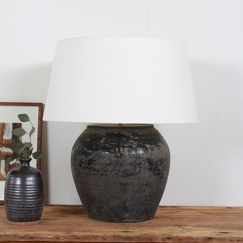 CHINESE STORAGE JAR CONVERTED LAMP WITH WHITE  LINEN DRUM SHADE