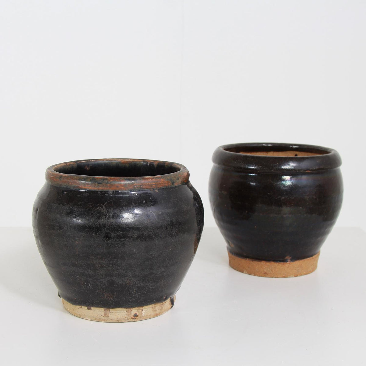 COLLECTION OF TWO CHINESE ANTIQUE GLAZED POTTERY JARS