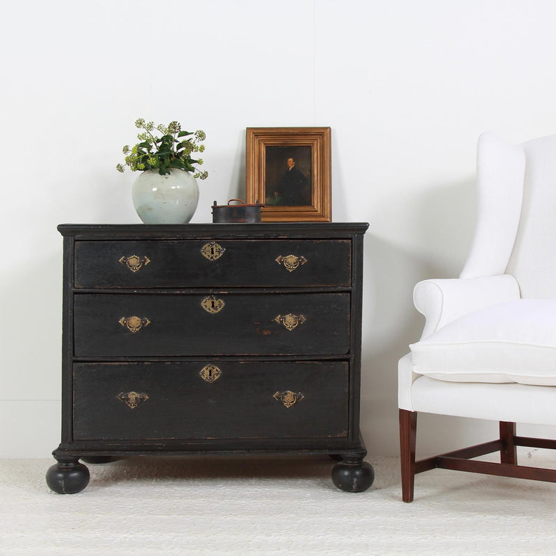 ENGLISH 18TH CENTURY COMMODE IN STRIKING BLACK PATINA