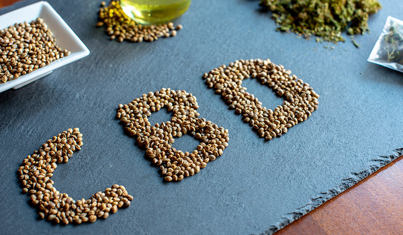 What does CBD stand for? CBD written in hemp seeds