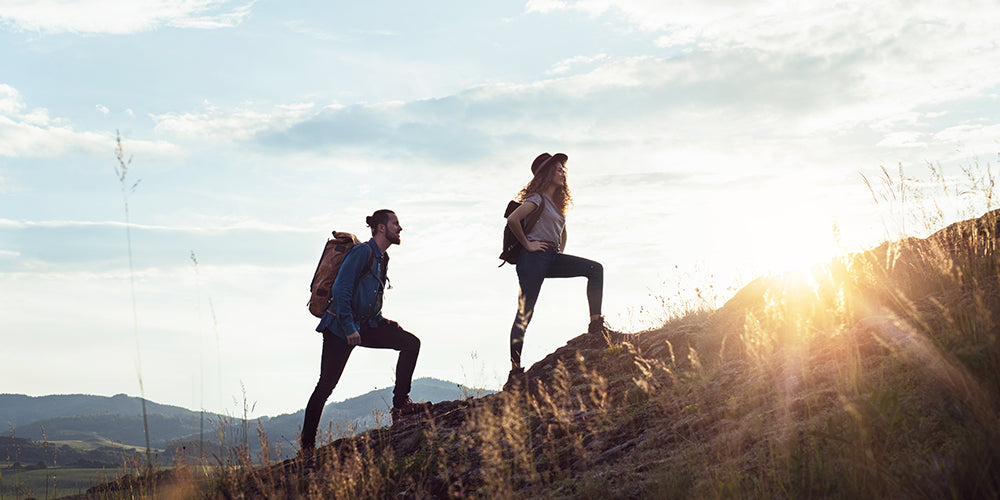 Couple hiking outside after taking CBD
