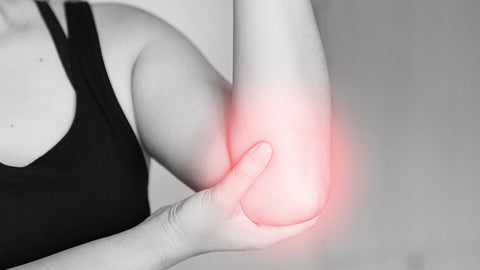 woman showing pain in elbow joint