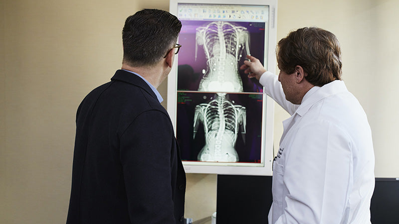 Man looking at xrays with his doctor. When was the endocannabinoid system discovered? What is the endocannabinoid system?