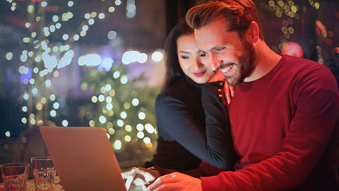 adult couple looking at laptop. Is hemp seed oil the same as cbd oil?