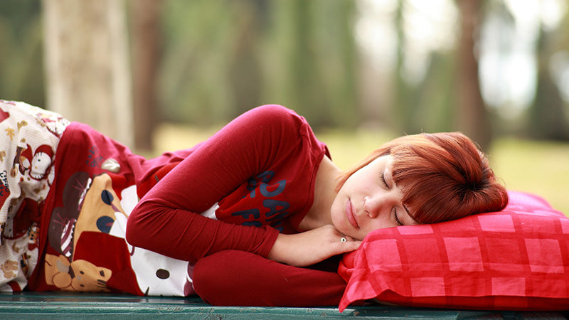 Woman taking a nap outdoors. advanced cbd oil with terpenes for sale. buy cbd terpenes oil. terpenes in cbd oil.