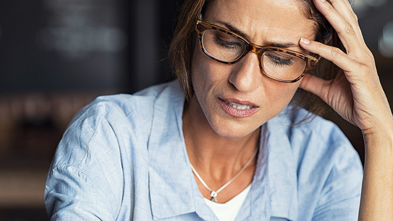 stressed-woman-wearing-eyeglasses. how to use cbd hemp oil for anxiety. hemp oil for sale online USA.