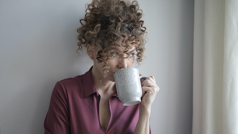 Adult woman drinking coffee. where to buy hemp oil.