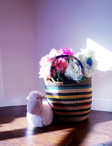 naamita basket bag used as a flower pot