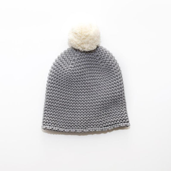 grey chunky knit beanie hat with white pom pom