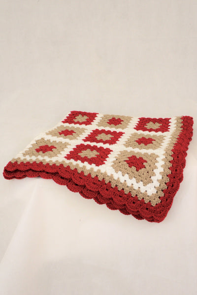 Red, white and brown crocheted knee rug