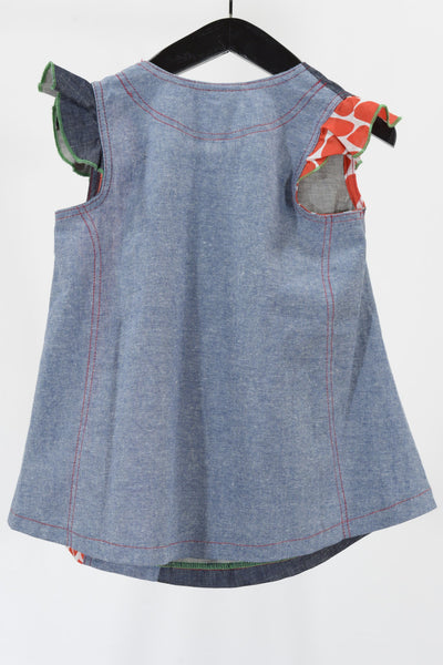 Oishi-m baby dress, denim blue and red, back view.