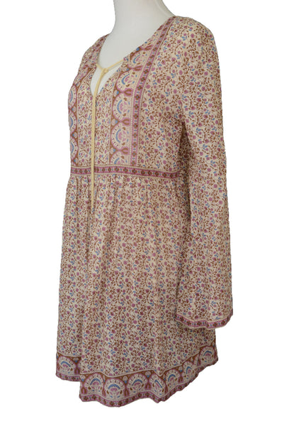 Tree of Life boho dress, pink and brown floral, long sleeved, side view.