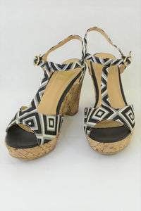 Women's No! wedge shoes, black and white geometric design.