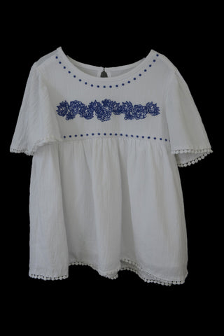 Preloved Pumpkin Patch girl's white top with blue embroidery.