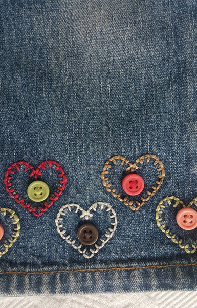 Button and heart stitch detail on Gymboree toddler jeans