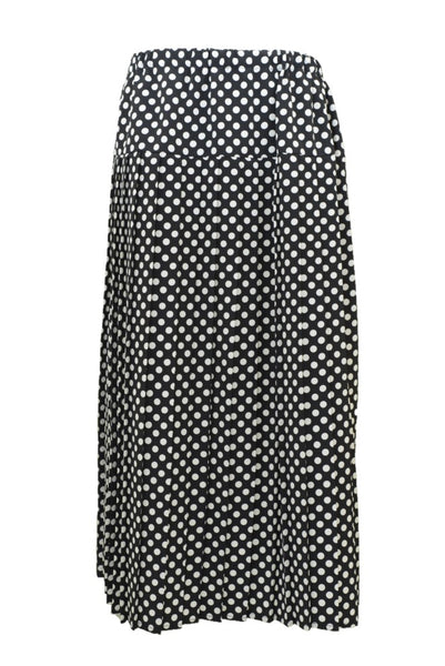 Preloved vintage pleated skirt, black and white spots, side view