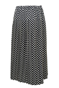 Preloved vintage pleated skirt, black and white spots, front view