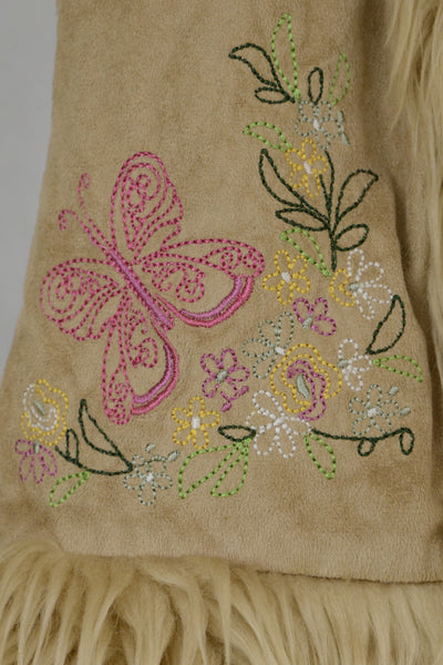 Butterfly and floral stitching detail on girl's vest