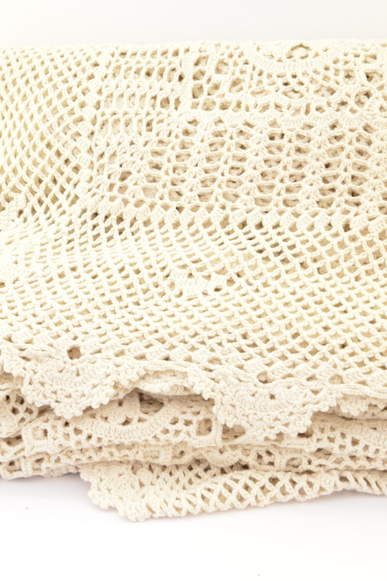 Cream crocheted tablecloth
