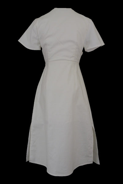 Atmos & Here white linen wrap dress with short sleeves, back view