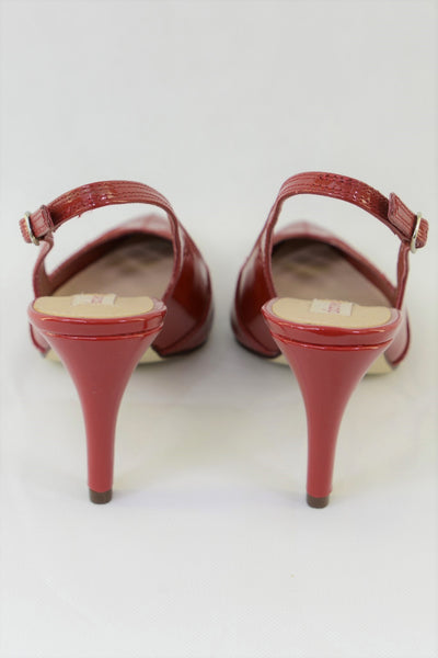 Red heels on Diana Ferrari slingback shoes.