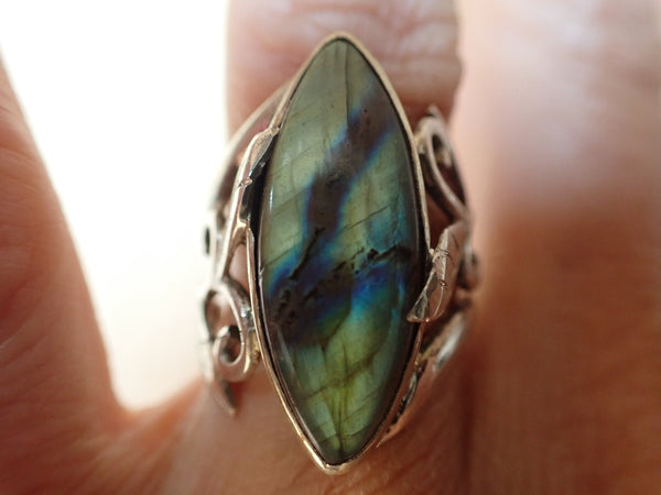Green and blue labradorite stone in silver ring
