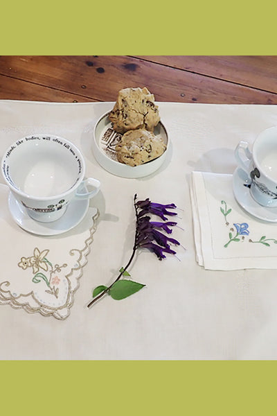 Tea setting with vintage embroidered napkins