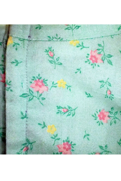 Hand-made cotton floral dress fabric and stitching