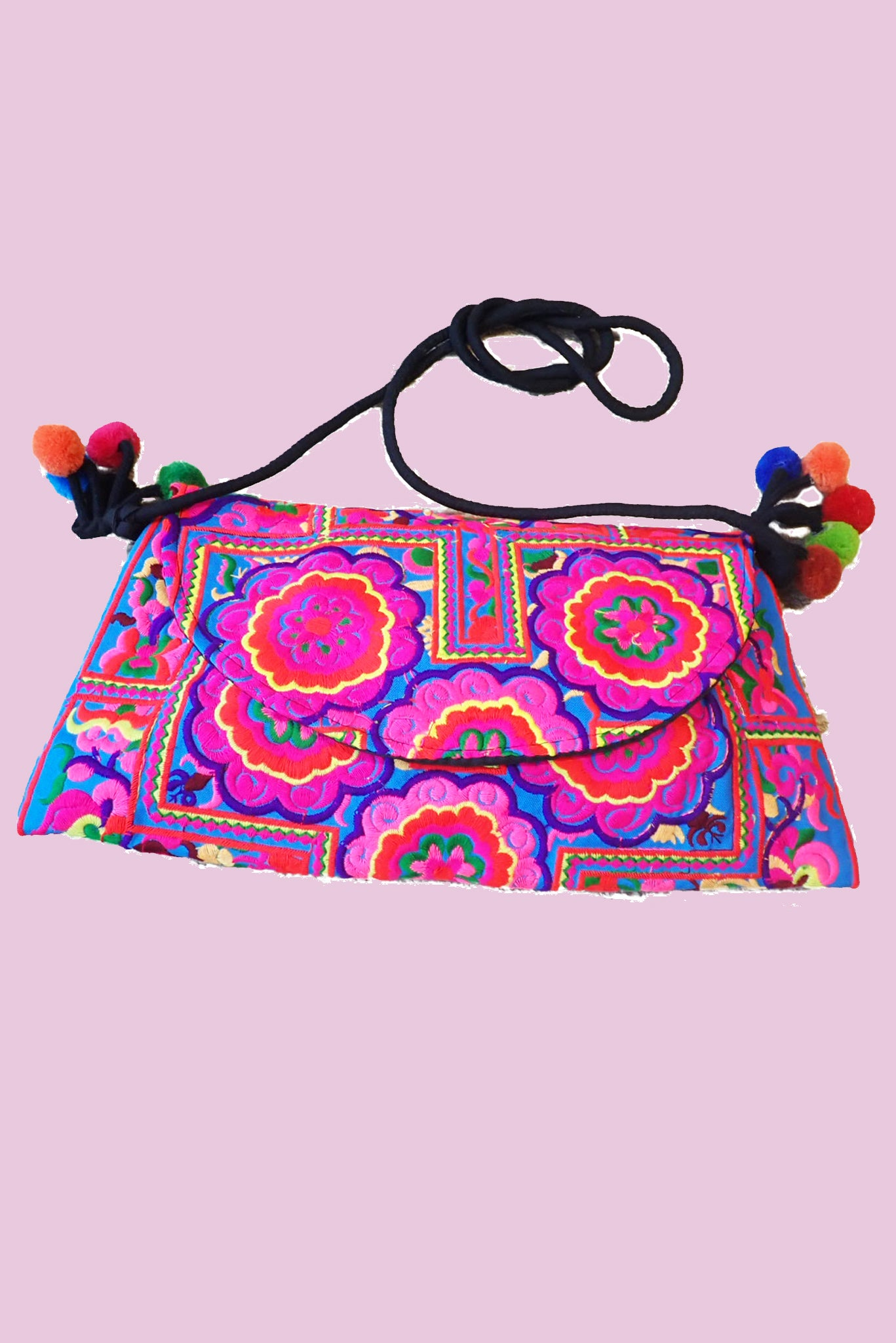 Brightly coloured fabric handbag with pompoms