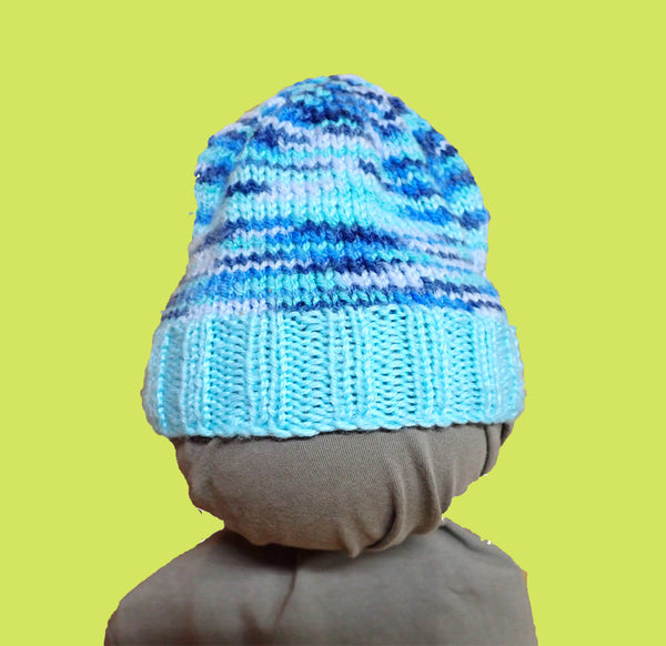 Blue hand-knitted baby beanie on mannequin