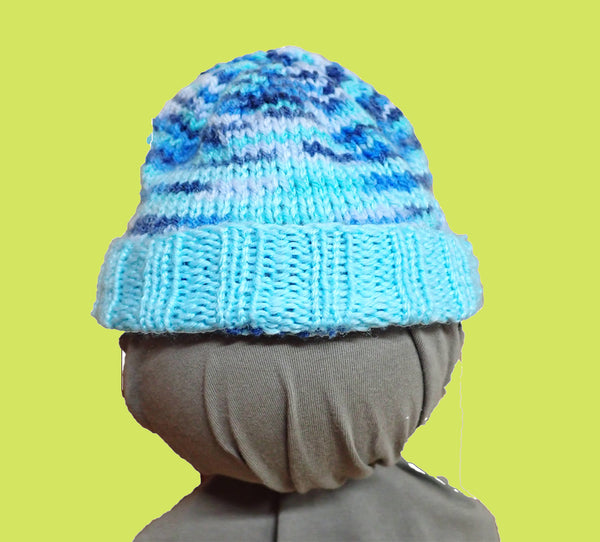 Blue baby beanie, folded up, on mannequin