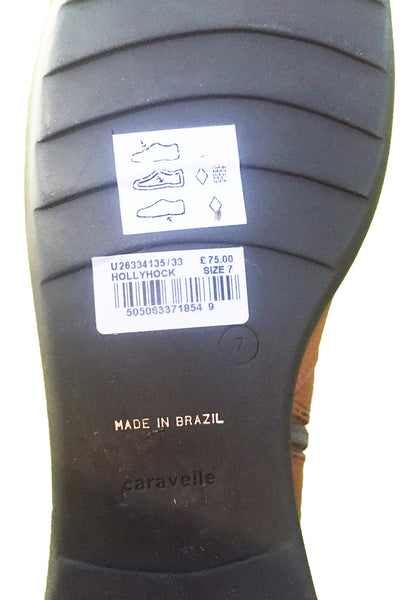 Caravelle Hollyhock boots showing price tag and sole.