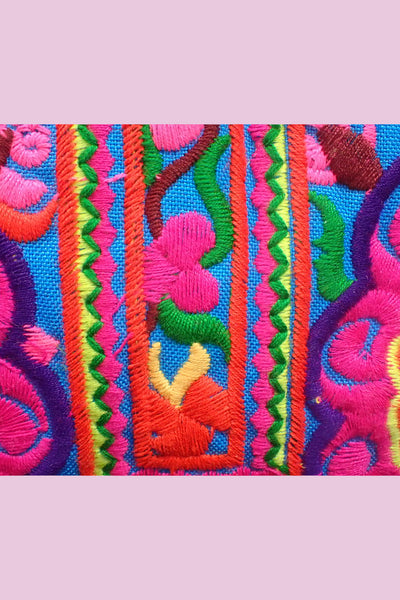 Brightly coloured fabric, green, pink, orange, blue
