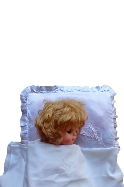 vintage doll's satin pillowcase with doll for scale