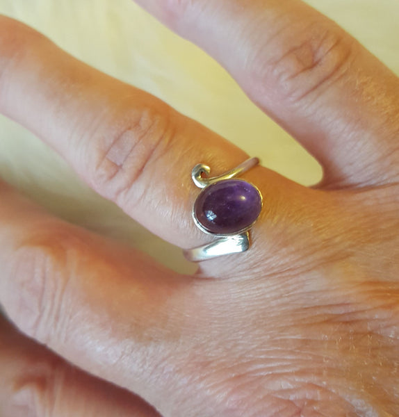 Handcrafted sterling silver and amethyst ring on hand model