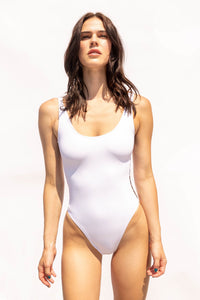 White bathing suit. The most flattering one-piece swimsuit. High leg and Brazilian bottom cut.