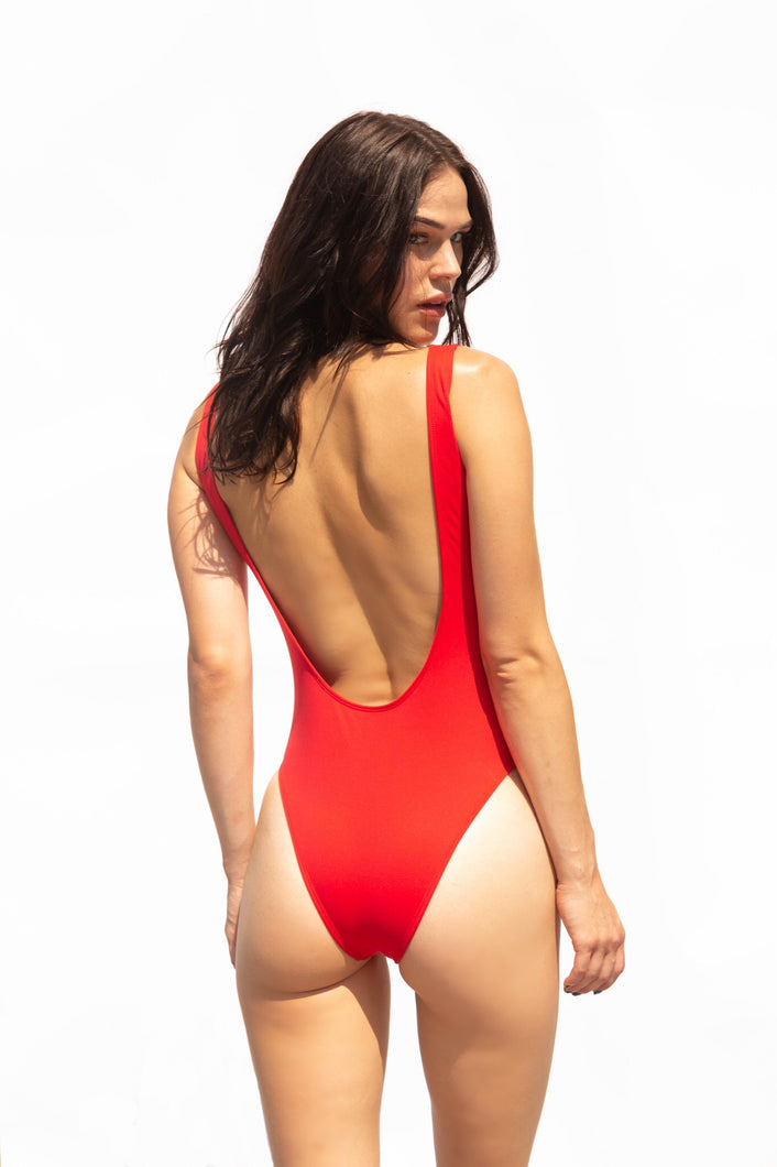 Luxury red one-piece swimsuit. The perfect bathing suit for you. Low back, low flattering chest line, high leg, Brazilian bottom cut. Very on trend.