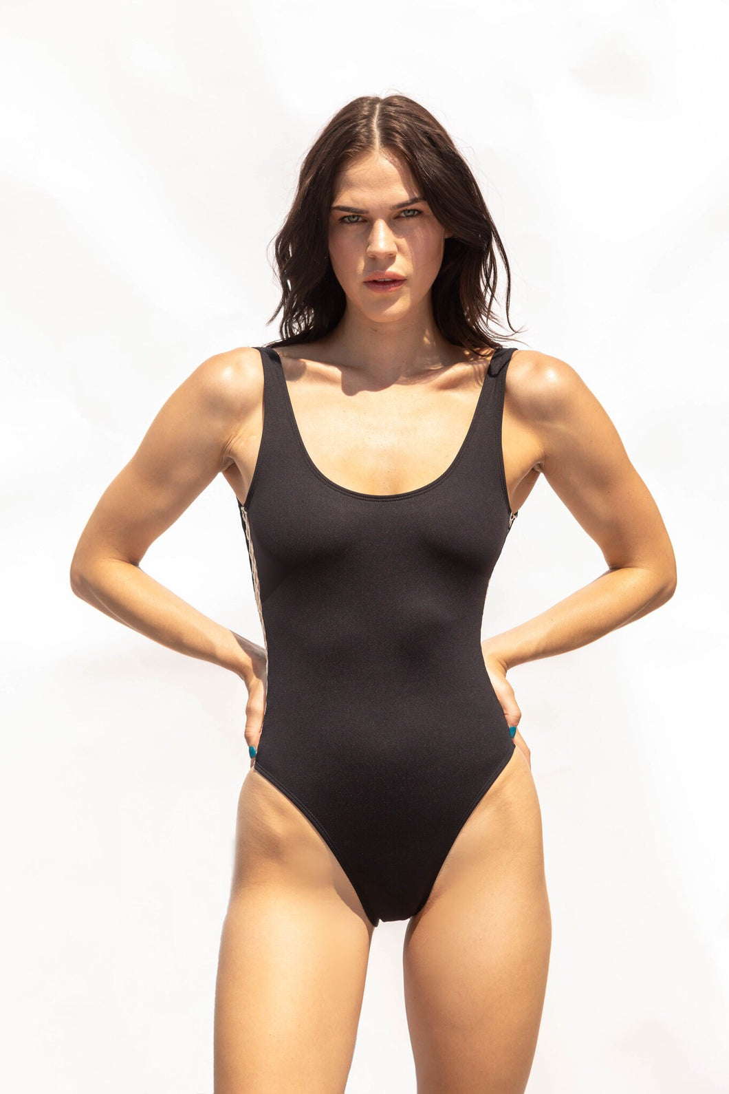 Black bathing suit. The most flattering one-piece swimsuit. High leg and Brazilian bottom cut.