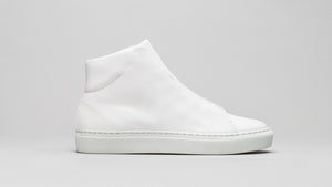 Secondary side view of the DiVERGE Minimal High White Canvas sneakers/trainers